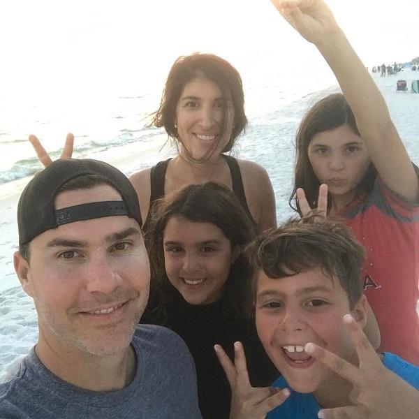 Ken Corsini with wife Anita Corsini and children