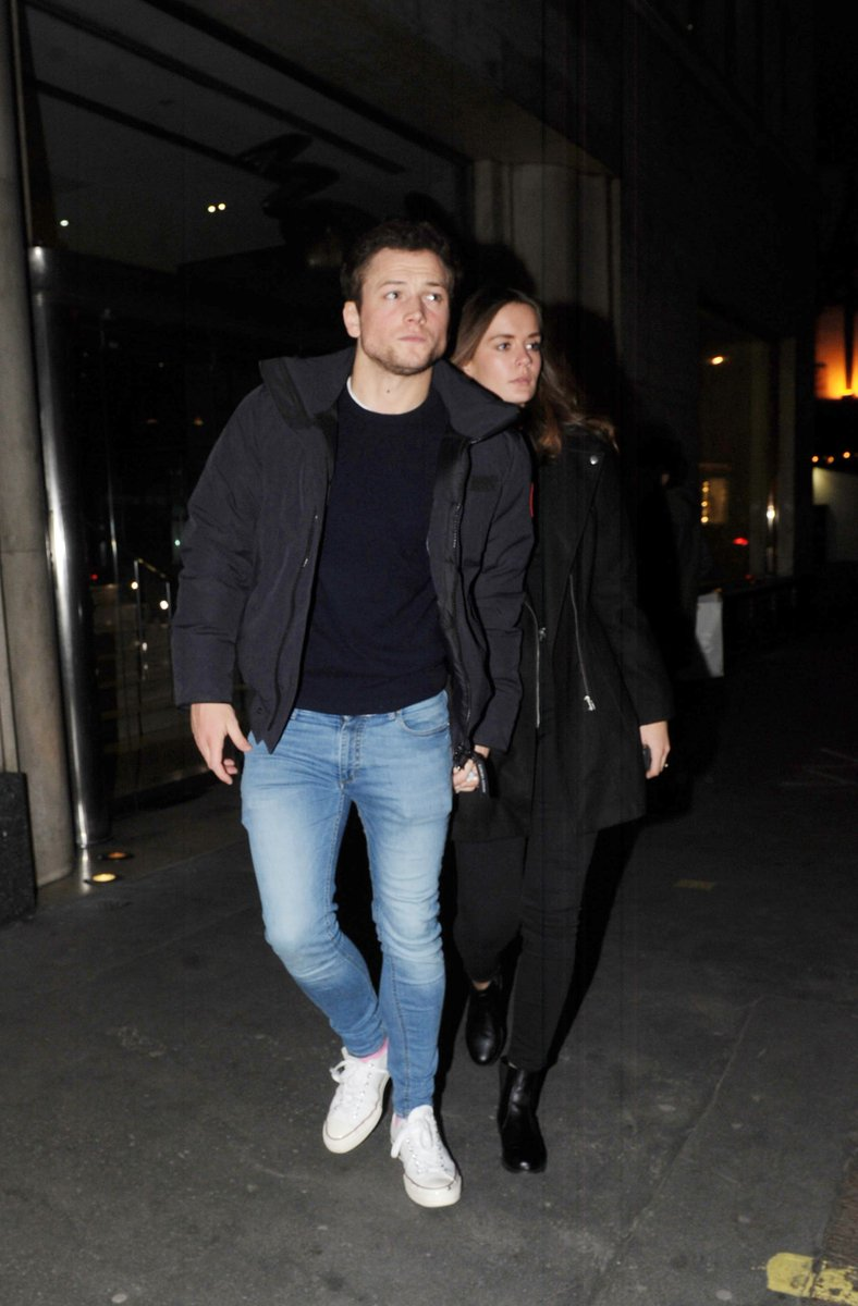 Taron Egerton and Emily Thomas leaving hotel