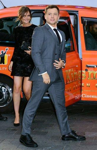 Taron Egerton with his girlfriend Emily Thomas at Kingsman Premiere