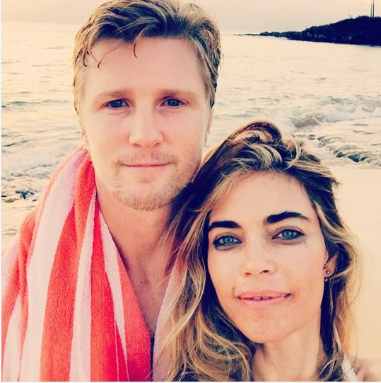 Amelia Heinle with her husband Thad