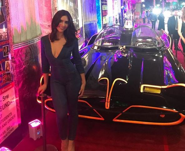 Camila Banus in front of Batmobile