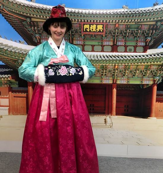 Millie Knight in traditional Korean dress