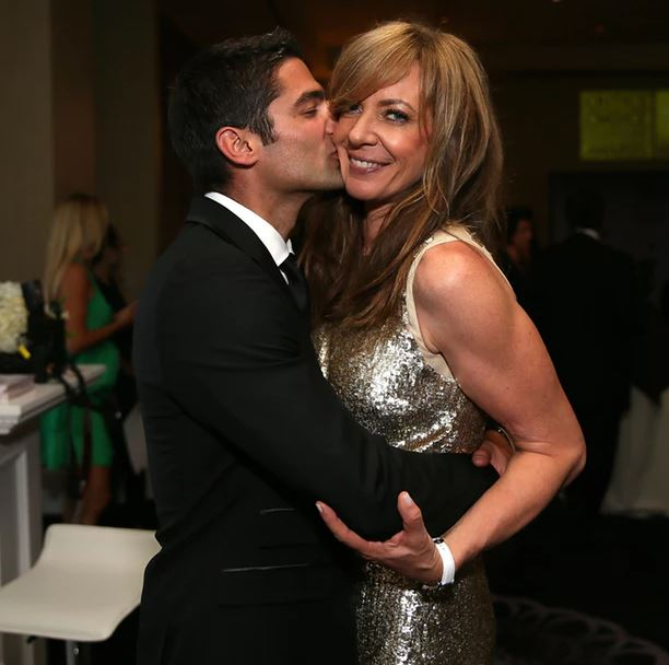 Philip Joncas kissing his girlfriend Allison Janney
