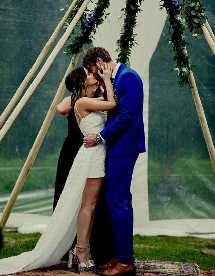 Ryan kissing his wife Maren after wedding