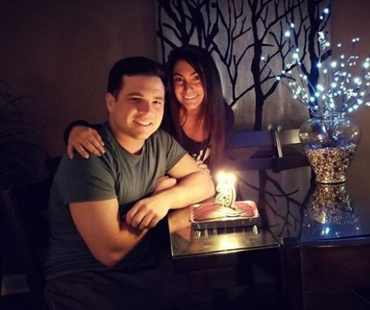 Deena with her husband Christopher in his birthday