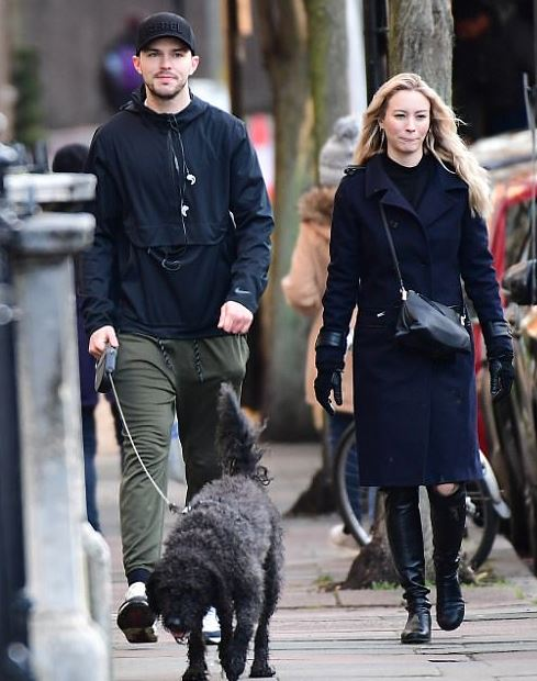 Nicholas Hoult with his girlfriend Bryana Holly
