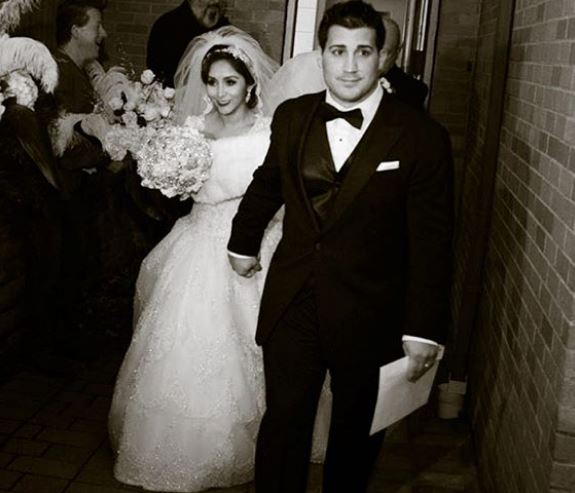 Snooki with her husband Jionni Lavalle on wedding day