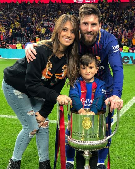Antonella with her husband and a child
