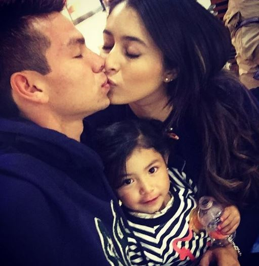 Lozano with his wife, Ana Opp and child