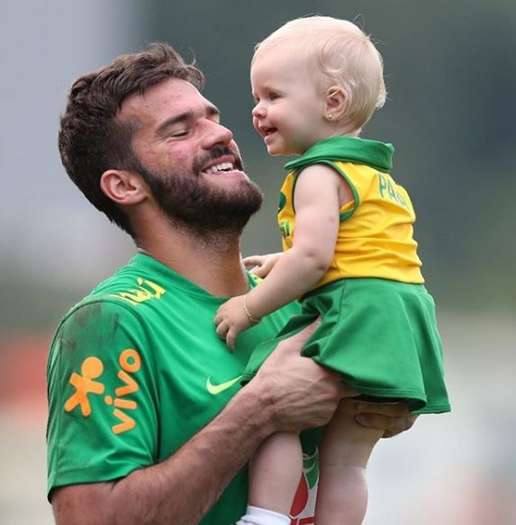 Alisson with his daughter