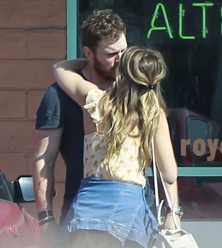 Katherine and Chris spotted sharing few kisses
