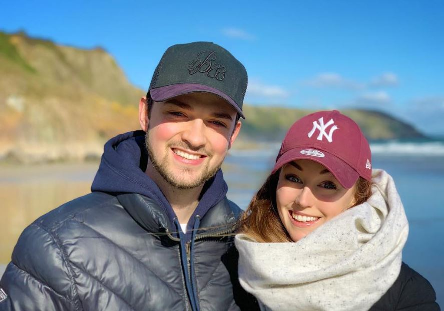 Ali-A with his girlfriend, Clare Siobhán on a beach