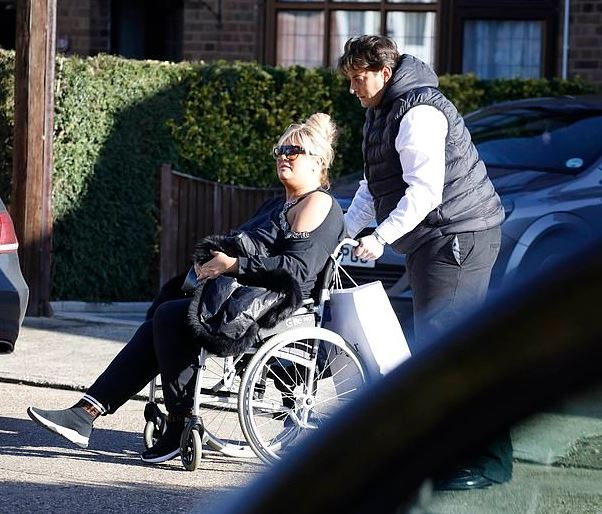 James pushing Gemma on wheelchair after fall
