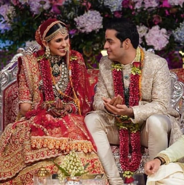 Shloka with her husband, Akash Ambani on the wedding