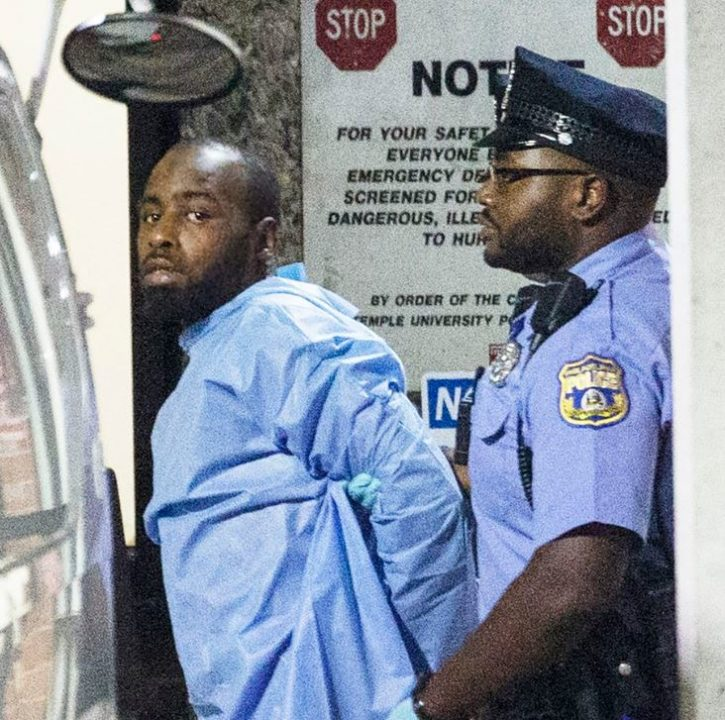 Maurice being handcuffed by a cop