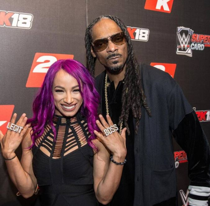 Sasha Banks and Snoop Dogg
